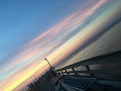 """Scott Kelly releases a photo on Twitter with the following caption: """"""""Cool pastel #sunset in Virginia Beach last night!"""""""". Photo Credit: Twitter *** No USA Distribution *** For Editorial Use Only *** Not to be Published in Books or Photo Books ***  Please note: Fees charged by the agency are for the agency's services only, and do not, nor are they intended to, convey to the user any ownership of Copyright or License in the material. The agency does not claim any ownership including but not limited to Copyright or License in the attached material. By publishing this material you expressly agree to indemnify and to hold the agency and its directors, shareholders and employees harmless from any loss, claims, damages, demands, expenses (including legal fees), or any causes of action or allegation against the agency arising out of or connected in any way with publication of the material."""