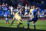 Millwall's  Martyn Woolford © challenges Cardiff's Eoin Doyle. Skybet football league championship, Cardiff city v Millwall at the Cardiff city stadium in Cardiff, South Wales on Saturday 18th April 2015<br /> pic by Andrew Orchard, Andrew Orchard sports photography.