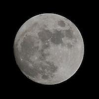 Full moon is seen on the night sky.