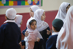 Children in the assembly hall at the Nottingham Islamia school,