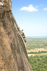 Climbers On Cliffs Of Ancient City of Sigiriya