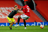 Football - 2019 / 2020 Premier League - Manchester United vs Southampton<br /> <br /> Aaron Wan-Bissaka of Manchester United and James Ward-Prowse of Southampton at Old Trafford<br /> <br /> COLORSPORT/LYNNE CAMERON