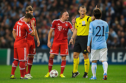 Bayern Midfielder Franck Ribery (FRA) waves his finger as referee Bjorn Kuipers (NED) talks to Man City Midfielder David Silva (ESP) during the second half of the match - Photo mandatory by-line: Rogan Thomson/JMP - Tel: Mobile: 07966 386802 - 02/10/2013 - SPORT - FOOTBALL - Etihad Stadium, Manchester - Manchester City v Bayern Munich - UEFA Champions League Group D.