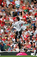 Photo: Steve Bond.<br />Arsenal v Derby County. The FA Barclays Premiership. 22/09/2007. Mathieu Flamini (front) beats Matt Oakley
