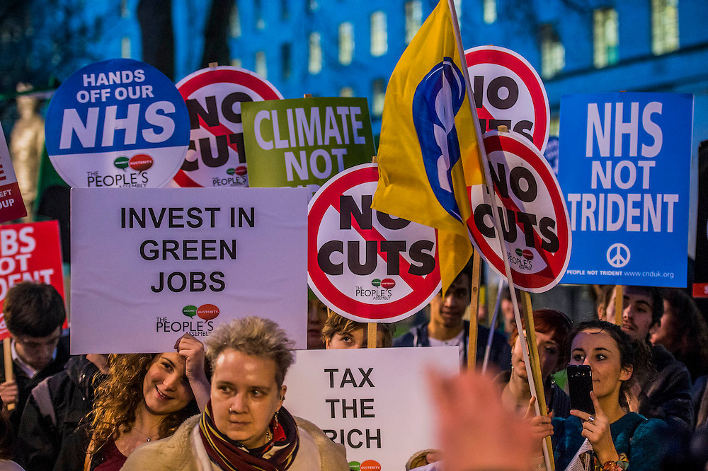 A Budget Day  protest against cuts and austerity is supported by Caroline Lucas, Green Party, John McInally - National vice president of the PCS union, CND and various student bodies.  At the same time a petition is handed in to Downing Street. Opposite Downing Street in Whitehall, London, UK 19 March 2014.