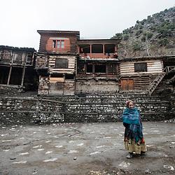 Bumburet, Chitral District,Pakistan.Pic Shows A Kalash woman in the Kalash village in tBumburet making