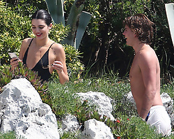 Kendall Jenner shows off her sensational figure in a racy black swimsuit as she soaks up the sunshine at luxury hotel pool after touching down in Cannes. 11 May 2018 Pictured: Kendall Jenner, Jordan Barrett. Photo credit: TPI/MEGA TheMegaAgency.com +1 888 505 6342