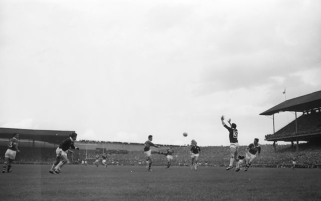 Kerry's P. Griffin, kicks ball over the bar as Galway's N. Tierney fails to stop it at the All Ireland Senior Gaelic Football final Kerry v. Galway in Croke Park on 27th September 1964. Galway 0-15 Kerry 0-10.