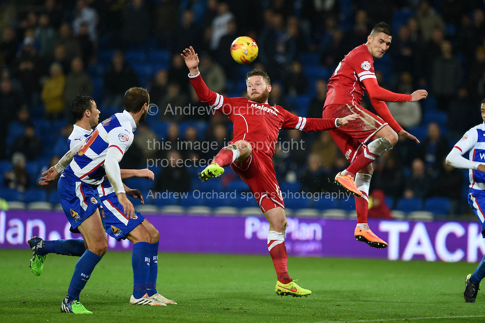 Cardiff city's Aron Gunnarsson © and Federico Macheda combine to clear the ball. Skybet football league championship match, Cardiff city v Reading at the Cardiff city stadium in Cardiff, South Wales on Friday 21st November 2014<br /> pic by Andrew Orchard, Andrew Orchard sports photography.