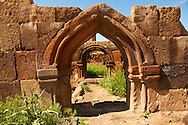 Ruined Armenian Gothic doorway. The Gothic  pointed arches in Ani pre date the European Gothic and are thought to be an influence for Western European Gothic. Ani archaelogical site on the Ancient Silk Road , Kars , Anatolia, Turkey .<br /> <br /> If you prefer to buy from our ALAMY PHOTO LIBRARY  Collection visit : https://www.alamy.com/portfolio/paul-williams-funkystock/ani-turkey.html<br /> <br /> Visit our TURKEY PHOTO COLLECTIONS for more photos to download or buy as wall art prints https://funkystock.photoshelter.com/gallery-collection/3f-Pictures-of-Turkey-Turkey-Photos-Images-Fotos/C0000U.hJWkZxAbg
