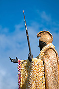 A vertical image of King Kamehameha with long lei on King Kamehameha Day in Hawaii.