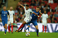 Alex Oxlade-Chamberlain of England holds off the challenge from Jan Durica of Slovakia ®.  FIFA World cup qualifying match, European group F, England v Slovakia at Wembley Stadium in London on Monday 4th September 2017.<br /> pic by Andrew Orchard, Andrew Orchard sports photography.