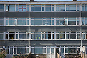 The windows of a 4 storey low-rise building on a housing estate in Norwich, Norfolk. United Kingdom