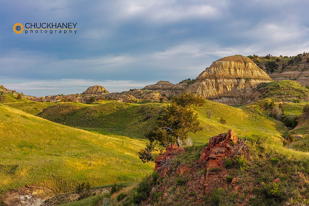 Colorful rock outcropping and badlands near Jones Creek in Theodore Roosevelt National Park, North Dakota, USA