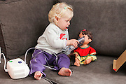 Baby uses her inhalation mask to treat her doll