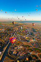 Aerial view, Hot air balloons lifting off from Balloon Fiesta Park, Albuquerque International Balloon Fiesta, Albuquerque, New Mexico USA.