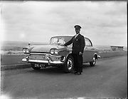 03/07/1961<br /> 07/03/1961<br /> 03 July 1961<br /> Irish Shell, Humber Snipe car with Mr Pike who was chauffeur for the visit of Prince Rainier and Princess Grace of Monaco. Note the Monaco coat of arms affixed to the grill.