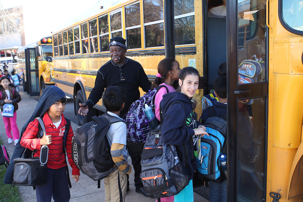 Bus drivers picking up students at T.H. Rogers.