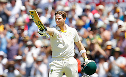 Australia's Steve Smith celebrates his century during day three of the Ashes Test match at the WACA Ground, Perth.
