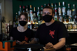 "Pictured: drianna Camoletto and manager Ethan Walch full of smiles to be back working again.<br /> <br /> The New Town Fox on Edinburgh's Dundas Street was open for business today for the first time in months like many bars and resaurants in Scotland.<br /> <br /> Manager Ethan Walch was pleasantly pleased to see so many customers stopping in for a meal or other refreshments. Ethan said: ""It felt like a quiet Wednesday before the pandemic.  Hopefully things will pick up more as customers see the precautions in place to avoid a second wave of Covid 19."""