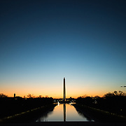 WASHINGTON, DC--The predawn light reflects off the still waters of the Lincoln Memorial Reflecting Pool, with the Washington Monument in the center of the frame.