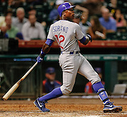 Sept 12, 2012; Houston, TX, USA; Chicago Cubs left fielder Alfonso Soriano (12) hits a home run against the Houston Astros during the fifth inning at Minute Maid Park. Mandatory Credit: Thomas Campbell-US PRESSWIRE