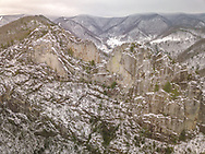 An early winter snowfall at Seneca Rocks reveal outline of layered rock pillars nestled among the mountain folds below North Fork Mountain in West Virginia.