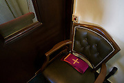 A Priest's Stole on his seat before confessional at St. Lawrence's Catholic church in Feltham, London.