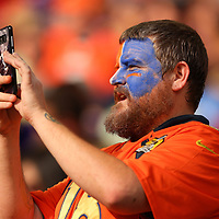 MINNEAPOLIS, MINNESOTA - AUGUST 14: A Denver Broncos fan takes a photo on his cell phone in the fourth quarter of preseason play against the Minnesota Vikings at U.S. Bank Stadium on August 14, 2021 in Minneapolis, Minnesota. (Photo by Adam Bettcher/Getty Images)