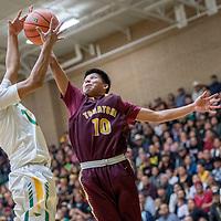 Newcomb Skyhawk Nichloas Tsipai (11), left, and Tohatchi Cougar Justin Leonard (10) vie for a rebound in the boys District 1-3A championship at Newcomb High School Friday.
