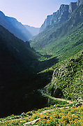 """Hike Vikos Gorge in Vikos-Aoos National Park, north Pindus Mountains (Pindos or Pindhos), Zagoria, Epirus/Epiros, Greece, Europe. Vikos Gorge in northern Greece is the world's deepest canyon in proportion to its width, and at one point measures 2950 feet (900 meters) deep and 3600 feet (1100 meters) wide from rim to rim. Its depth is an impressive 82% of its width at that cross-section (depth/width ratio=0.82). Gorges in many countries have higher depth/width ratio, but none are as deep. Zagori (Greek: ) is a region and a municipality in the Pindus mountains in Epirus, in northwestern Greece. Zagori contains 45 villages collectively known as Zagoria (Zagorochoria or Zagorohoria). Published in """"Pindos: The National Park"""" (2010) by Alexander G. Tziolas, preface by Tom Dempsey et al, ISBN 978-960-98795-3-8."""