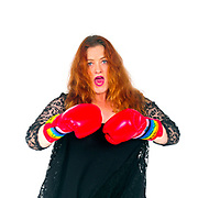 Survival. Business Woman in her 40s with boxing gloves On white Background