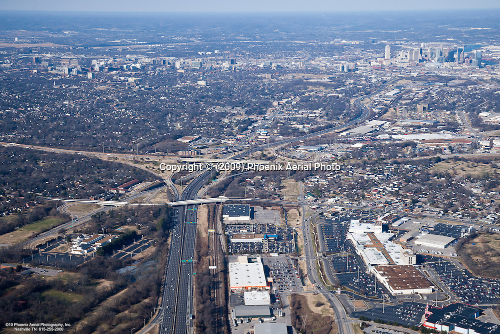 Aerial photo of I-65 showing 100 Oaks, Thompson Lane and I-440 with the Nashville Skyline in the background.