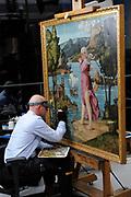 Staatsbezoek van de President van Slowakije , Zijne Excellentie president Ivan Gasparovic en zijn echtgenote Silvia Gasparovicova.<br /> <br /> Statevisit of the President of  Slowakije Ivan Gasparovic and his wife  Silvia Gasparovicova.<br /> <br /> Op de foto/ On the photo: <br /> <br />  Een Restaurator aan het werk in het restauratieafdeling van het Rijksmuseum met een schilderij van Girolamo dai Libri <br /> <br /> Restorers at work in the restoration department of the National Museum