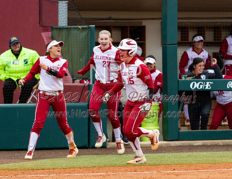 #15 Lea Wodach scoring another point for the Oklahoma Sooners during the their game against Iowa State, Sunday, April 08, 2018, at Marita Hynes Field.