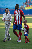 Atletico Madrid's new Colombian striker Jackson Martinez plays with his son during his presentation as new player of the Spanish Primera Division soccer club at Vicente Calderon stadium in Madrid, Spain. July 26, 2015. (ALTERPHOTOS/Victor Blanco)