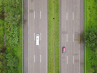 Top down aerial view of cars passing through pune-lonavla highway in maharashtra state of India.
