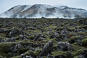 Steam from Geothermal springs in volcanic landscape. Iceland.