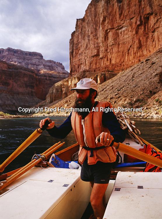 Kenton Grua stand-up rowing his wooden dory Bright Angel through Marble Canyon at Nankoweap, Grand Canyon National Park and Navajo Reservation, Arizona.