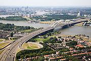 Nederland, Zuid-Holland, Rotterdam-Zuid, 04-07-2006; zicht op de meanderende rivier de Nieuwe Maas met de Van Brienenoordbrug; rechtsonder dorpskern Oud IJsselmonde; verstedelijking, urbanisatie, skyline ; luchtfoto (toeslag); aerial photo (additional fee required); .foto Siebe Swart / photo Siebe Swart