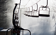 Snow guns coat the slope, trees and chairlift at Timberline Ski Resort on a bitter-cold January day.