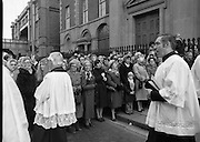 Funeral Of Frank Duff.   (N50)..1980..13.11.1980..11.13.1980..13th November 1980..The Solemn Funeral Mass for Frank Duff, founder of The Legion of Mary,was concelebrated with his Eminence,Cardinal Tómas O'Fiaich,Archbishop of Armagh and Primate of All Ireland as principal celebrant, at St Andrew's Church, Westland Row,Dublin. The funeral took place after the mass to Glasnevin Cemetery..Image of the crowd standing in Westland Row as the remains of Frank Duff are carried from the church.