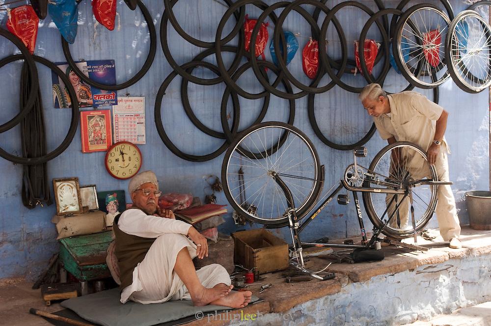 Bicycle fixer in Jodhpur, Rajasthan, India