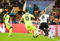 Valencia's Sofiane Feghouli and KAA Gent's Kenneth Saief, Nana Asare during Champions league match. October 20, 2015. (ALTERPHOTOS/Javier Comos)