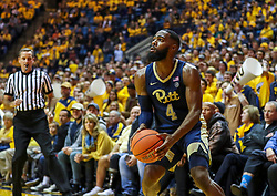 Dec 8, 2018; Morgantown, WV, USA; Pittsburgh Panthers guard Jared Wilson-Frame (4) shoots a three pointer during the first half against the West Virginia Mountaineers at WVU Coliseum. Mandatory Credit: Ben Queen-USA TODAY Sports