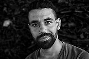 Black and white portrait of an informal rubbish collector in Istanbul Turkey. <br /> In Turkey, there are estimated to be as many as 500,000 waste pickers (toplayıcılar): Those making a living via the collection of recyclables off the street and from waste bins. <br /> The Ankara-based Street Waste Collectors Association (Sokak Atık Toplayıcıları Derneği) is demanding the creation of a legislation recognizing waste picking as a formal profession.<br /> John Wreford is a freelance professional photographer based in Turkey
