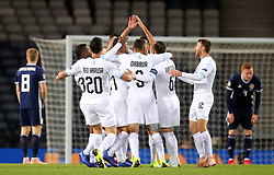 Israel's Beram Kayal (obscured) celebrates scoring his side's first goal of the game with team-mates during the UEFA Nations League, Group C1 match at Hampden Park, Glasgow.
