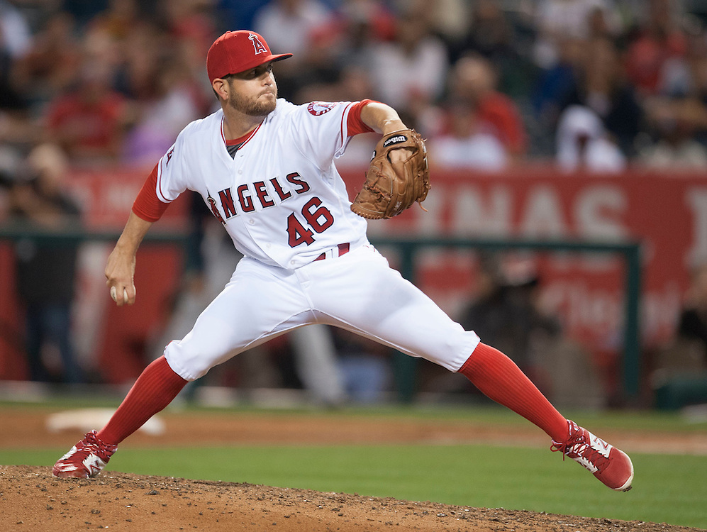 Making his second appearance since coming back from the disabled list, the Angels' Cory Rasmus pitches the ninth inning during the Angels' 6-2 loss to the Cleveland Indians Friday at Angel Stadium.<br /> <br /> ///ADDITIONAL INFO:   <br /> <br /> angels.0611.kjs  ---  Photo by KEVIN SULLIVAN / Orange County Register  -- 6/10/16<br /> <br /> The Los Angeles Angels take on the Cleveland Indians Friday at Angel Stadium.