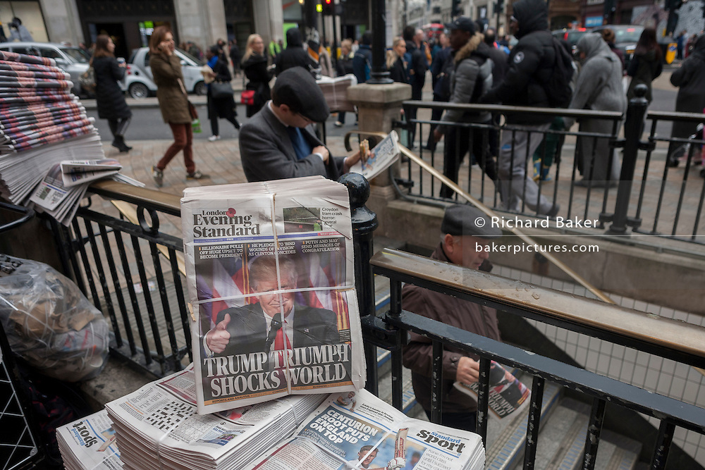 "US president-elect, Donald Trump appears on the front page of the London Evening Standard newspaper, on the day of his election, on November 9th 2016, in central London, England. The headline reads ""Trump Triumph Shocks World"" and Londoners of all colours and races take the free paper to read the latest overnight news. (Photo by Richard Baker / In Pictures via Getty Images)"