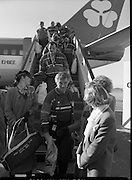 Irish Paralympic Team Arrive Home From Seoul.(R89).1988..28.10.1988..10.28.1988..28th October 1988..The Seoul Summer Paralympics 1988..The very successful Irish Paralympic team arrived home to Dublin today. The team managed a haul of 42 medals, 13 Gold, 11 Silver, 18 Bronze which earned them 19th place in the overall medal table...Image shows the paralympians disembarking from their Aer Lingus flight at Dublin Airport.